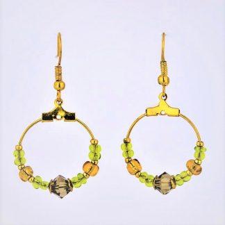 gull øredobber gull ørepynt gull øreringer små creolringer creol grønne perler grønne glassperler lysegrønne glassperler rav ravfargede perler ravfargede glassperler grønn krystall røkfarget krystall gull perlecaps øsken